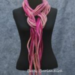 Shades of pink scarf made out of 9 felted strands