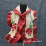 Felted scarf with rose motif and red ruffles