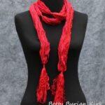 Red strands with glitz boa