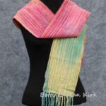 hand woven, painted warp scarf in yellow, green and red