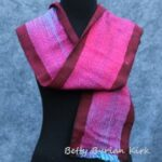 Hand woven, hand painted blue and purple scarf with black trim.