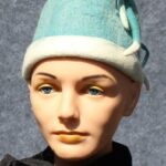 Turquoise cloche with White Accents and Plumes