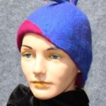 hand made wool, blue cloce with magenta accents and plumes