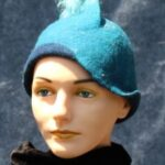 Turquoise cloche of hand made cloche with mohair locks