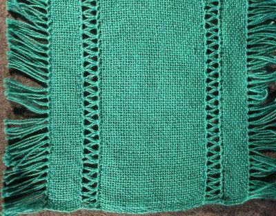 Hemstitching on woven goods